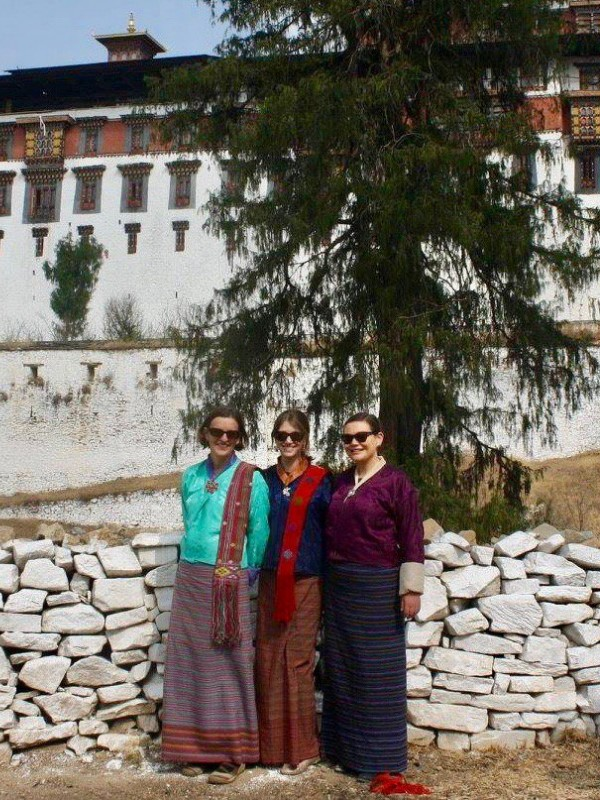 Kat middle with fellow Australian volunteers Rachel and Alison outside Paro Dzong a Buddhist monastery and fortress to attend the annual tshechu festival.