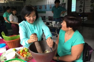 Australian volunteer Chris Kerr having a cooking lesson from Chanhpeng Silvia Director and Founder of Laos Womens Development Centre.